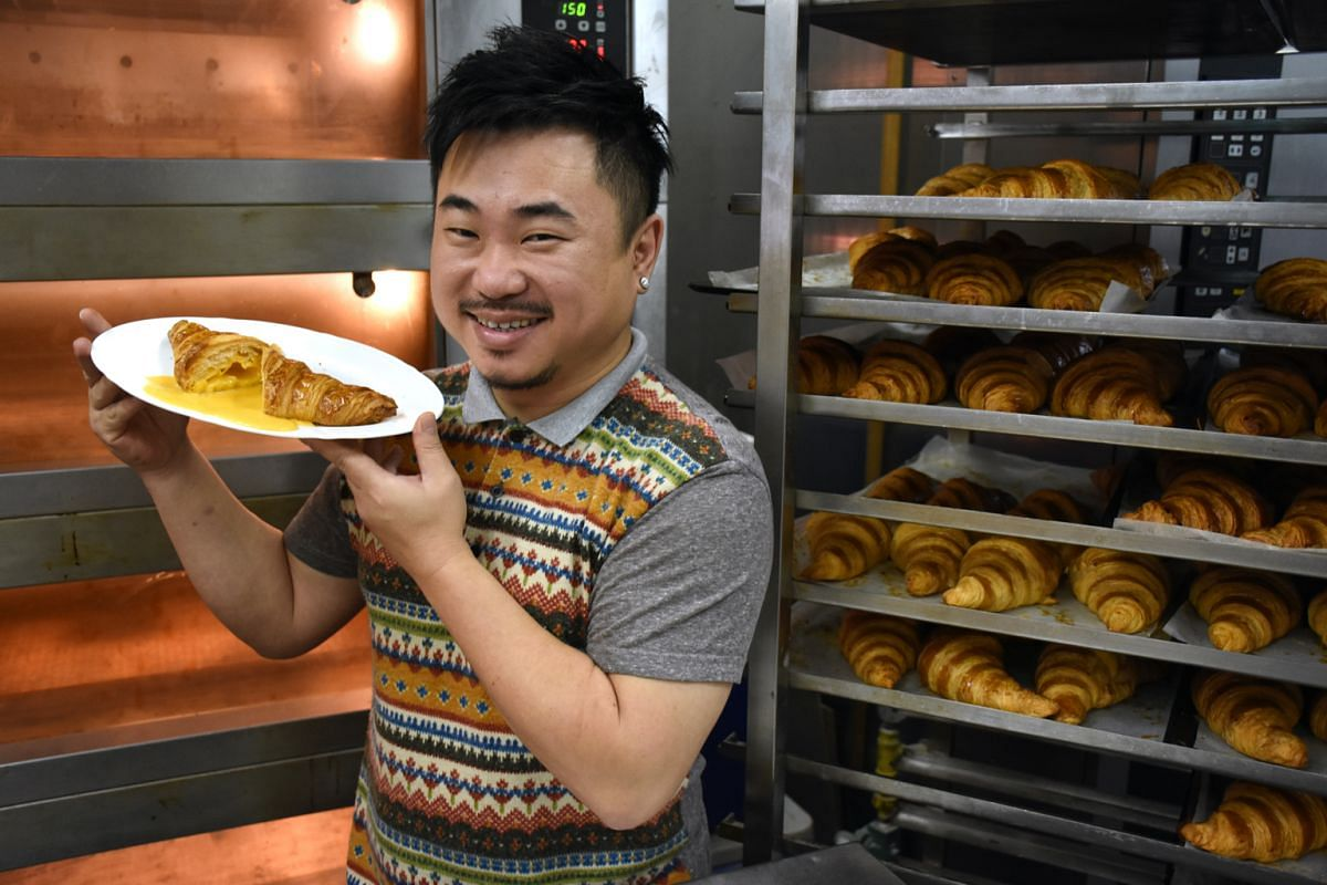 Da Paolo Gastronomia's Ms Francesca Scarpa, Antoinette's Pang Kok Keong (above) and Kokomama Marketplace director Francis Huang with their salted egg yolk custard croissants.