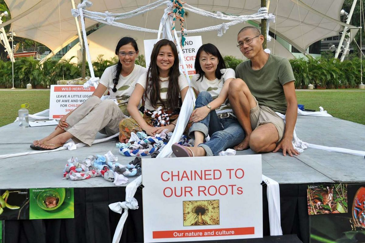 Wildlife activists (from left) Dr Vilma D'Rozario, Ms Teresa Teo Guttensohn, Ms Celine Low and Mr Andrew Tay tied themselves with old bedsheets on a stage in Hong Lim Park in 2013.