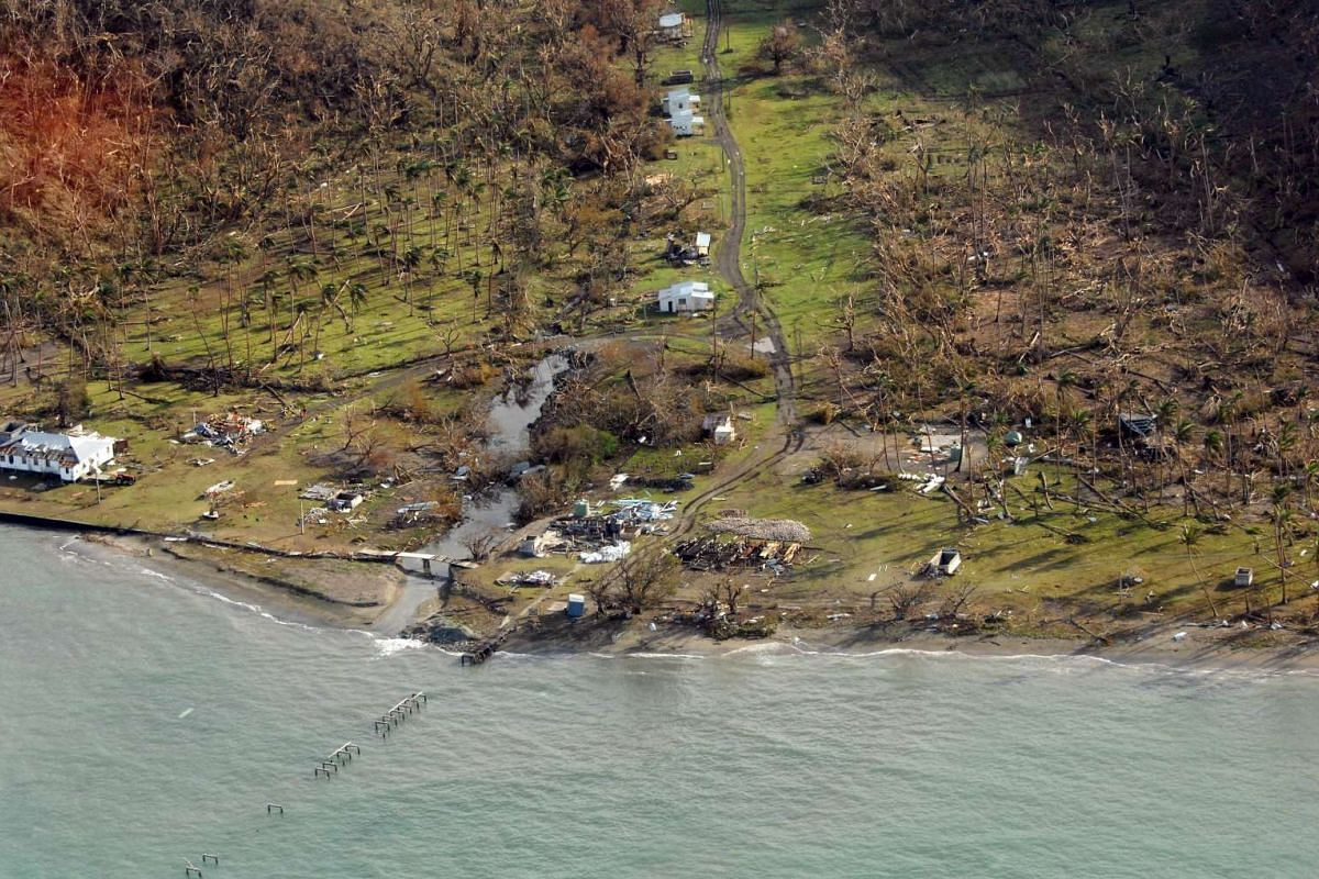 A remote Fijian village is photographed from the air during a surveillance flight conducted by the New Zealand Defence Force on February 21, 2016. Fiji began a massive cleanup on Monday after a powerful storm tore through the Pacific island nation.