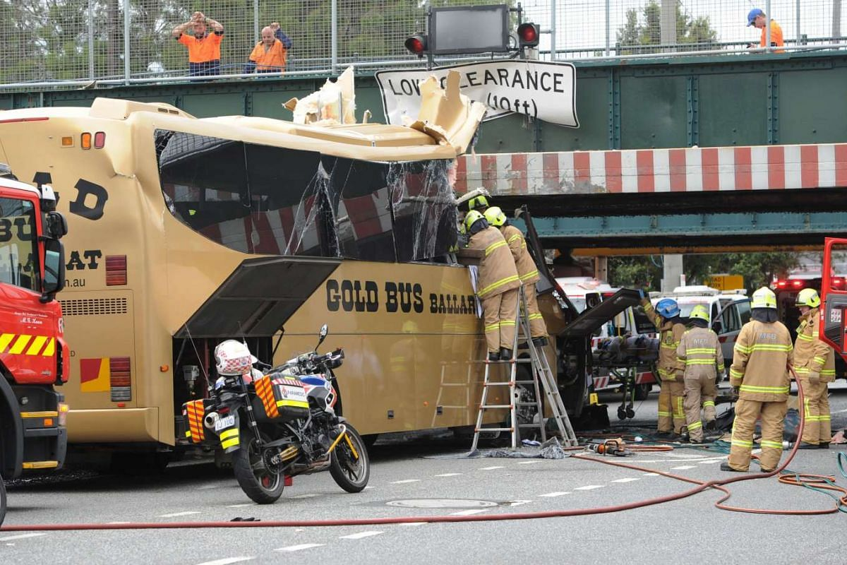 Emergency workers work at the scene where a bus crashed into an overhead barrier protecting a low bridge in South Melbourne, Australia February 22, 2016. PHOTO: REUTERS/MAL FAIRCLOUGH/AAP