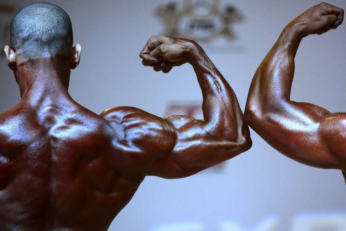 Participants take part in the Open International Bodybuilding Classic Paisa 2016 as part of Expofitness in Medellin, Antioquia department, Colombia on February 21, 2016. PHOTO: AFP/RAUL ARBOLEDA