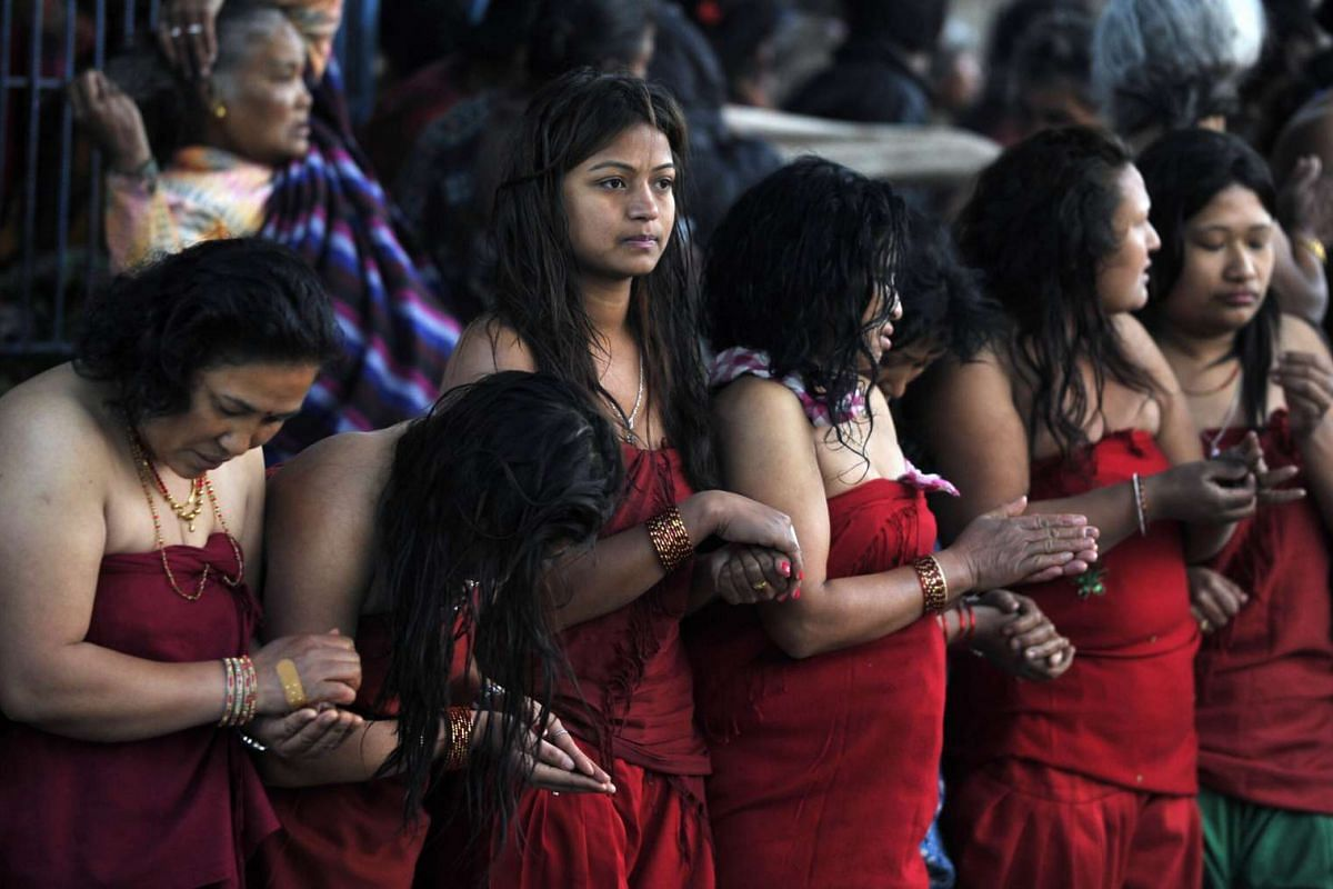 Nepalese devotees participate in a bathing ritual on the last day of the Swasthani Festival on Feb 22, 2016.