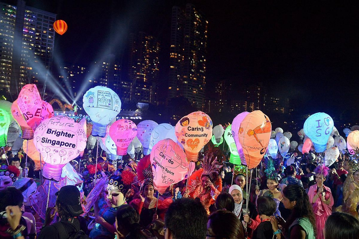 Performers holding sky lanterns with penned wishes at the Chingay 2016 Night Fiesta held at Bishan Park where PM Lee Hsien Loong was the guest-of-honour.