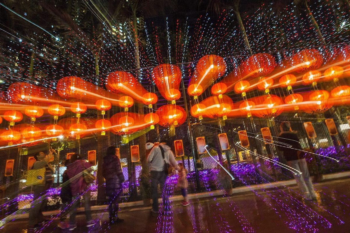 People looking at lanterns and traditional Fai Chun decorative messages in Po Tsui Park, Hong Kong, on Feb 20, 2016.