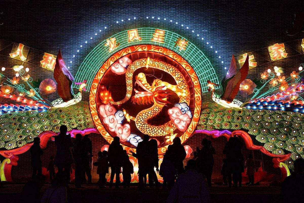 People walking through an exhibition of lanterns in a square in Handan, in China's northern Hebei province, on Feb 20, 2016.