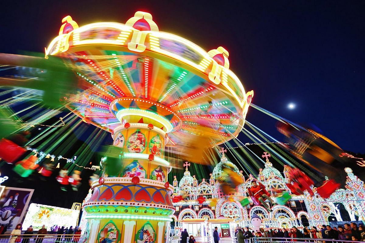 Visitors riding a carousel at Longqingxia Ice Lantern Festival in Yanqing district of Beijing, on Feb 20, 2016.
