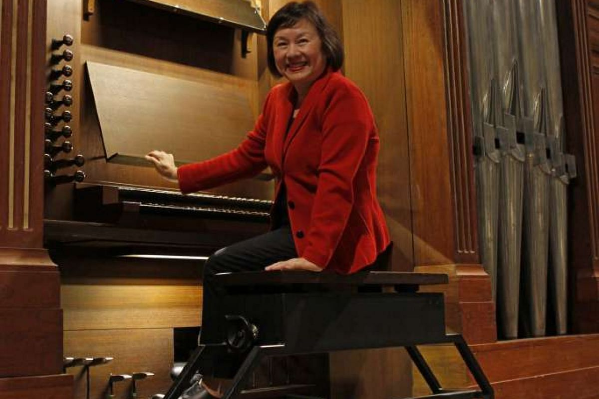 Organist Margaret Chen (above) at the Klais Organ at Victoria Concert Hall.