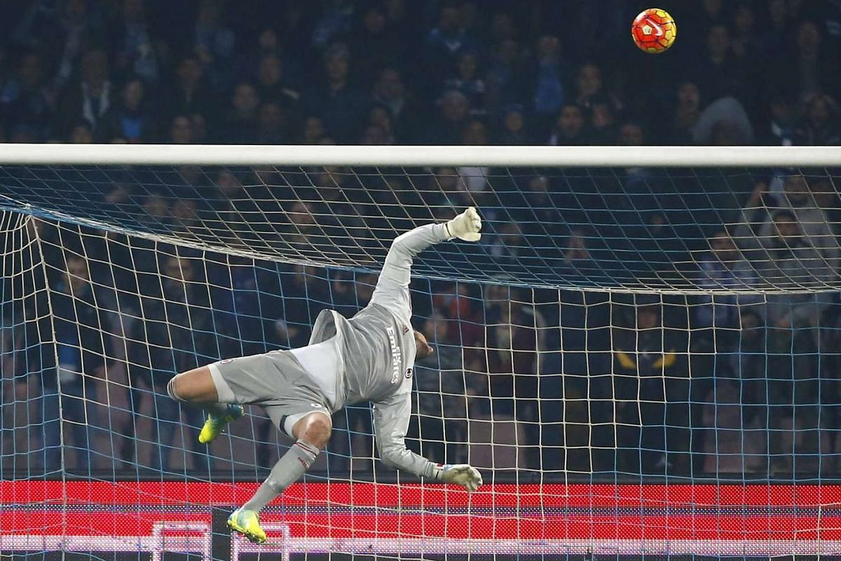 AC Milan's goalkeeper Gianluigi Donnarumma makes a save during the match against Napoli during the Italian Serie A held at San Paolo Stadium, Naples, Italy on Feb 22, 2016.  PHOTO: REUTERS
