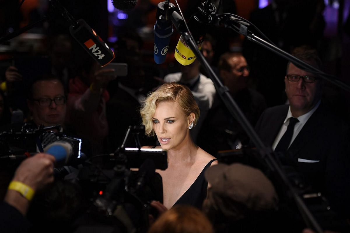 Charlize Theron talks to the media at the Cinema for Peace Gala during the 66th annual Berlin International Film Festival.