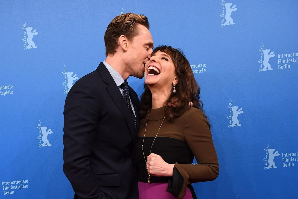 Tom Hiddleston (left) and director Susanne Bier arrive for the premiere of The Night Manager during the 66th annual Berlin International Film Festival.