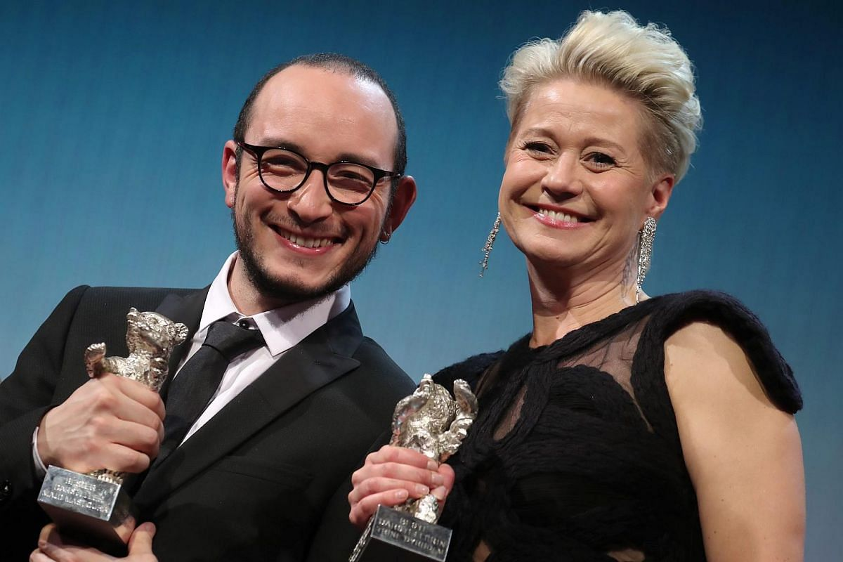 Winner of the Silver Bear for Best Actress Trine Dyrholm (right) for Kolektivet (The Commune) and the winner of the Silver Bear for Best Actor, Majd Mastoura in Inhebek Hedi (Hedi) pose during the Closing and Awards Ceremony of the 66th annual Berlin