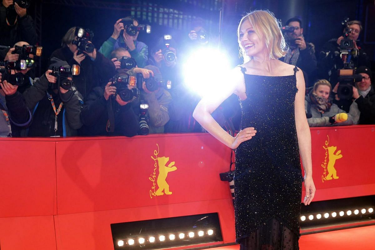 Kirsten Dunst arrives for the premiere of Midnight Special during the 66th annual Berlin International Film Festival.