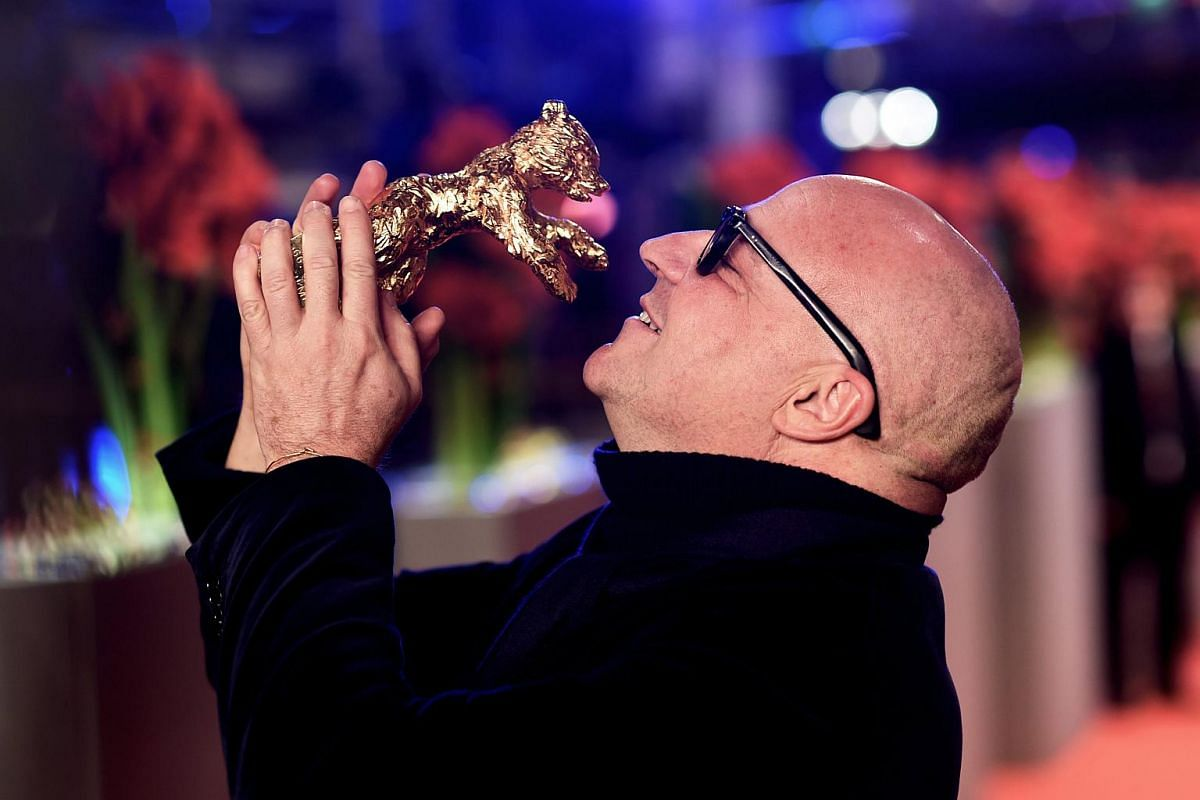 The winner of the Golden Bear for Best Film, Gianfranco Rosi for Fuocoammare (Fire at Sea) poses at the Closing and Awards Ceremony of the 66th annual Berlin International Film Festival.