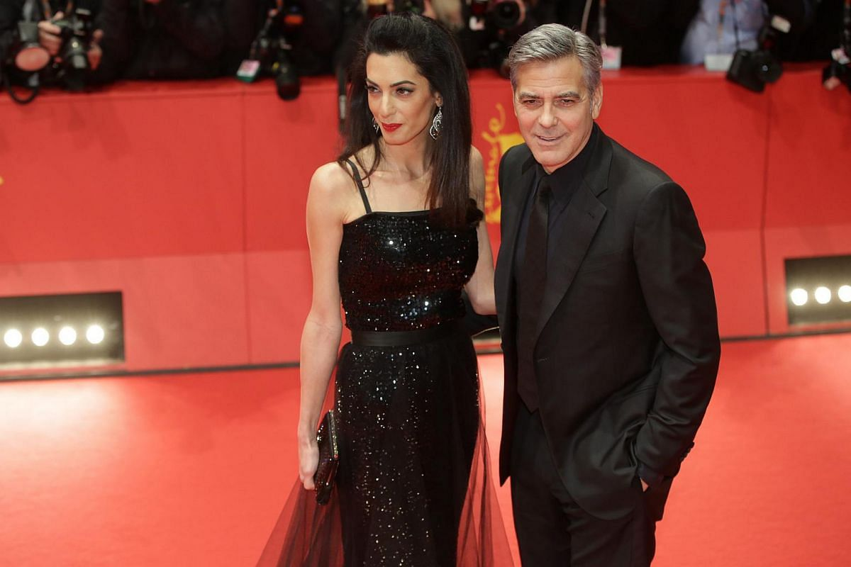 George Clooney and his wife Amal Clooney arrive for the Opening Ceremony of the 66th annual Berlin International Film Festival and the premiere of Hail Cesar.