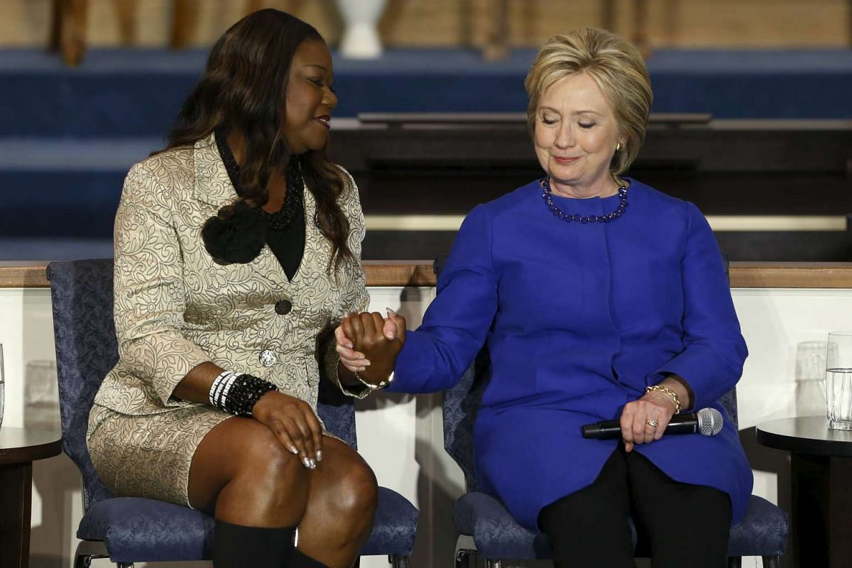 Sybrina Fulton (L), mother of shooting victim Trayvon Martin, endorses US Democratic presidential candidate Hillary Clinton during a town hall meeting at Central Baptist Church in Columbia, South Carolina, Feb 23, 2016. PHOTO: REUTERS/JONATHAN ERNST