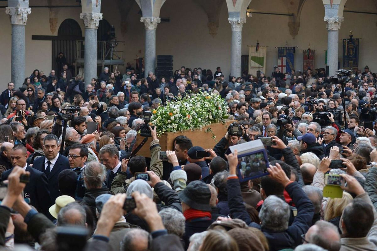Men carry the coffin of late Italian novelist Umberto Eco at the end of a civil ritual, on Feb 23, 2016, at the Sforza Castle in Milan. PHOTO: AFP/TIZIANA FABI