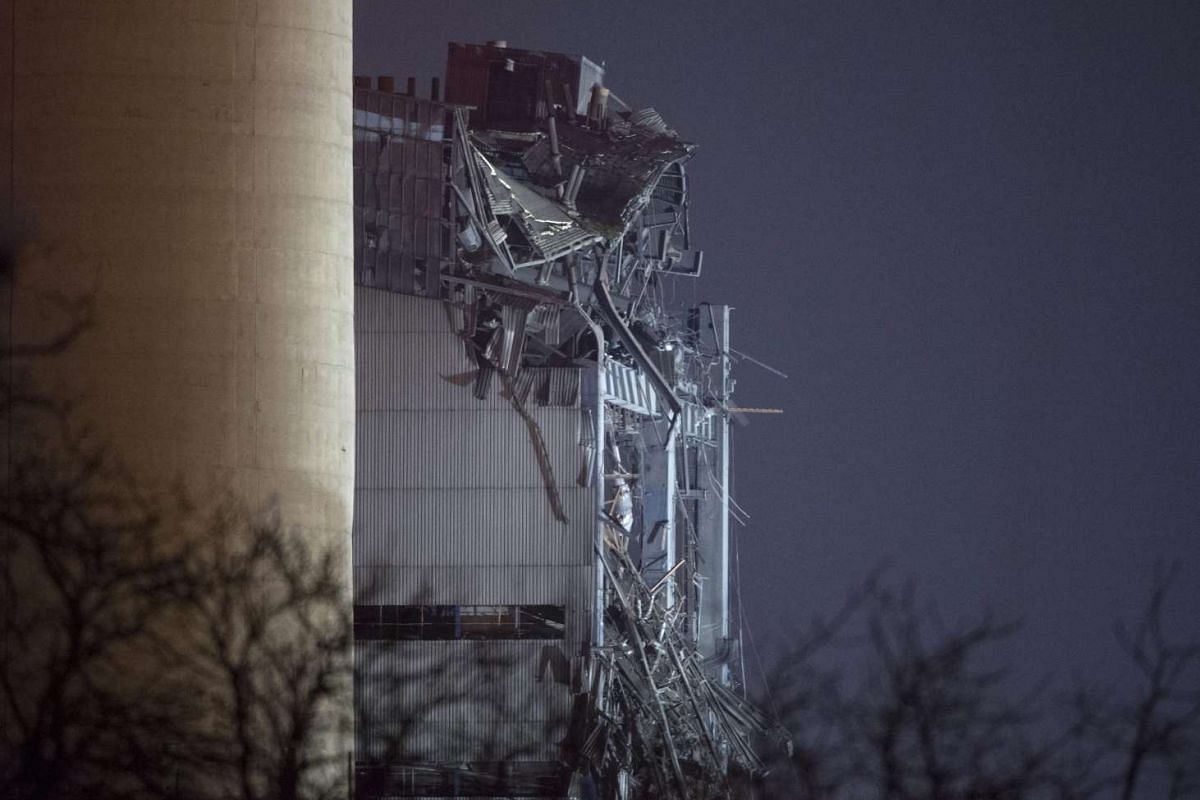 Part of the damaged building is visible at Didcot Power Station, Didcot, Oxfordshire, Britain, Feb 23, 2016. At least one person died after a building collapsed, following a possible explosion at the power station. PHOTO: EPA/HANNAH MCKAY