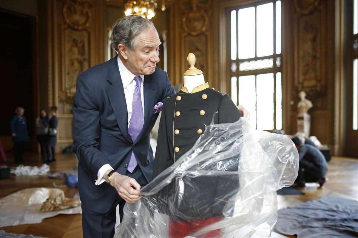 Christopher Forbes, vice-chairman of Forbes, unpacks the uniform worn around 1869-1870 by the crown Price, son of Napoleon III, before a preview show at the Paris Opera Garnier, France, Feb 23, 2016. Mr Forbes will be selling his vast collection of F