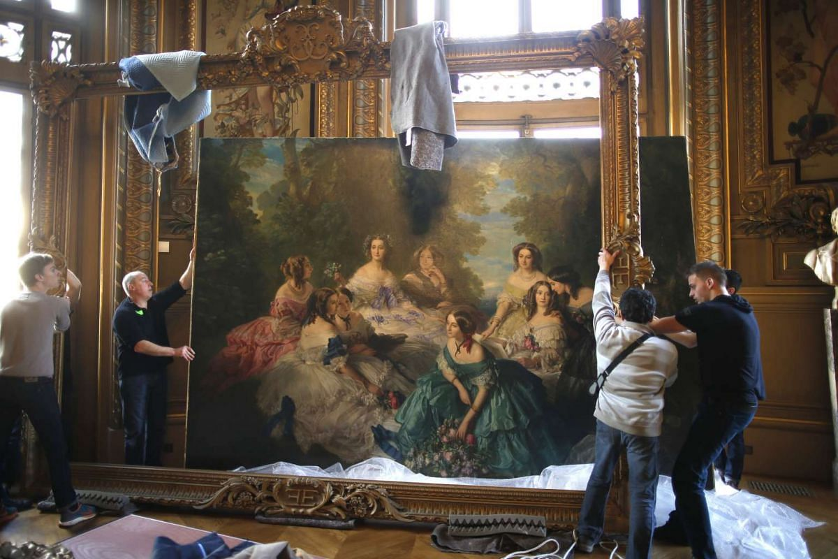 Workers set up the frame of a scene, painted in 1868 by Emile Boukerche, during a preview show at the Paris Opera Garnier, France, Feb 23, 2016. Mr Christopher Forbes, vice-chairman of Forbes, will be selling his vast collection of French Second Empi