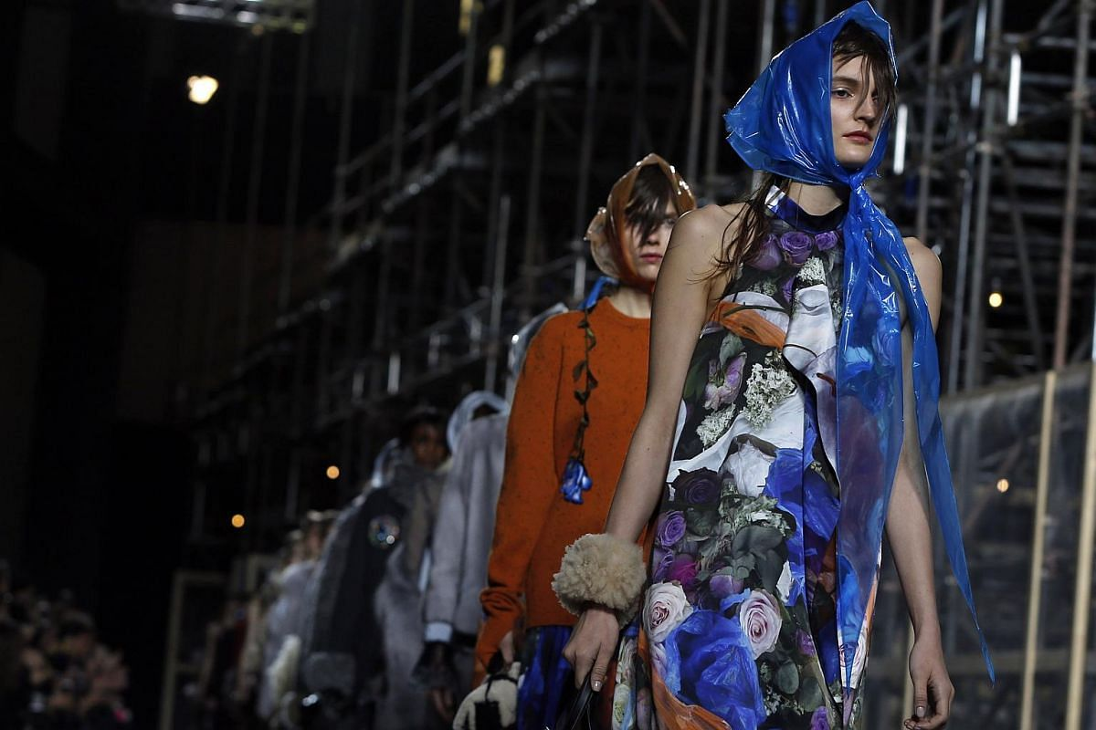 Models present creations at the Christopher Kane catwalk show at London Fashion Week Autumn/Winter 2016 in London, Britain.