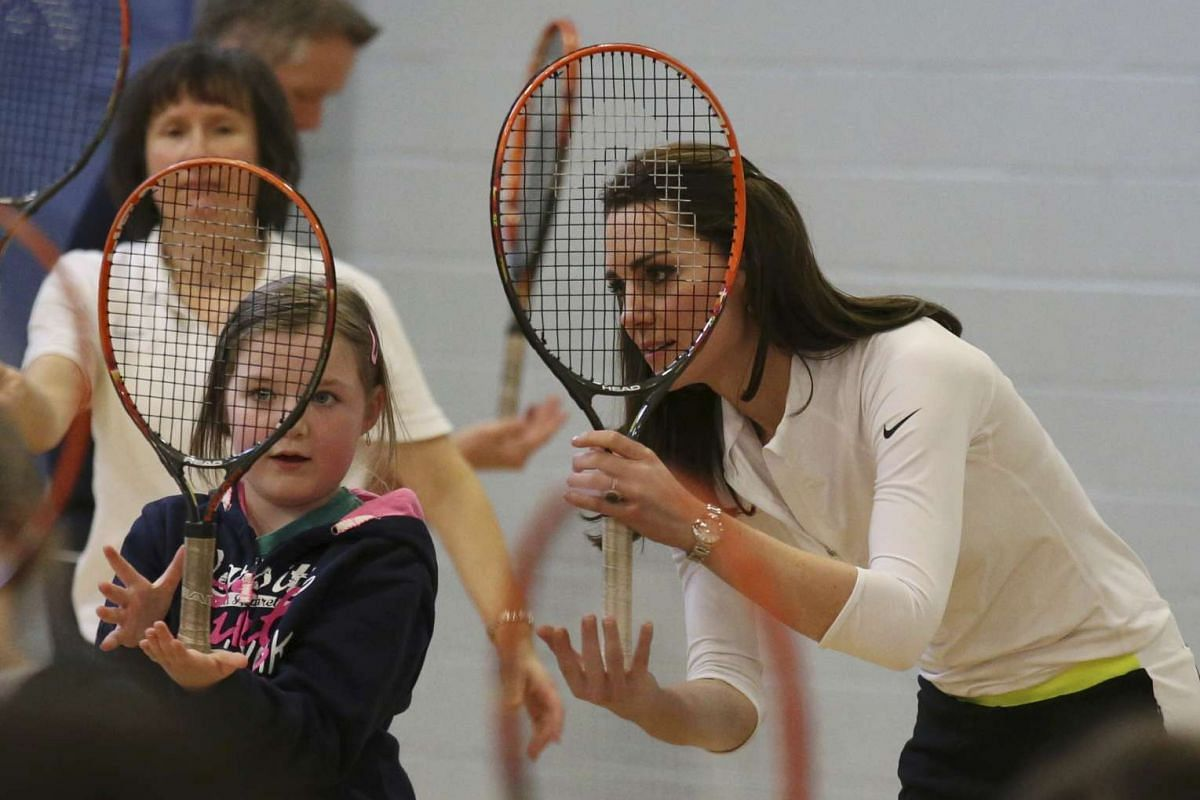 Britain's Catherine, Duchess of Cambridge takes part in a tennis workshop with Andy Murray's mother Judy at Craigmount High School in Edinburgh, Scotland, Feb 24, 2016. PHOTO: REUTERS/ANDREW MILLIGAN