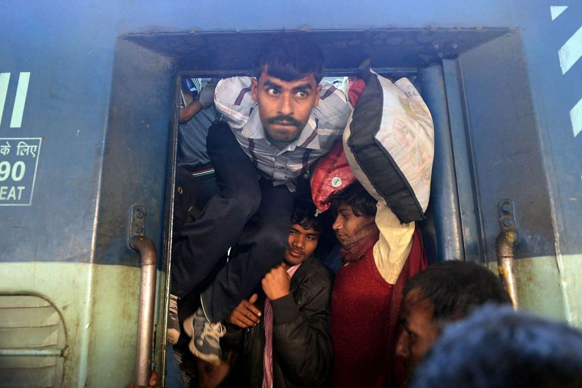 Indian passengers squeeze into the packed general wagon of The Simanchal Express at Anand Vihar Railway Station in New Delhi on Feb 25, 2016. PHOTO: AFP/PRAKASH SINGH