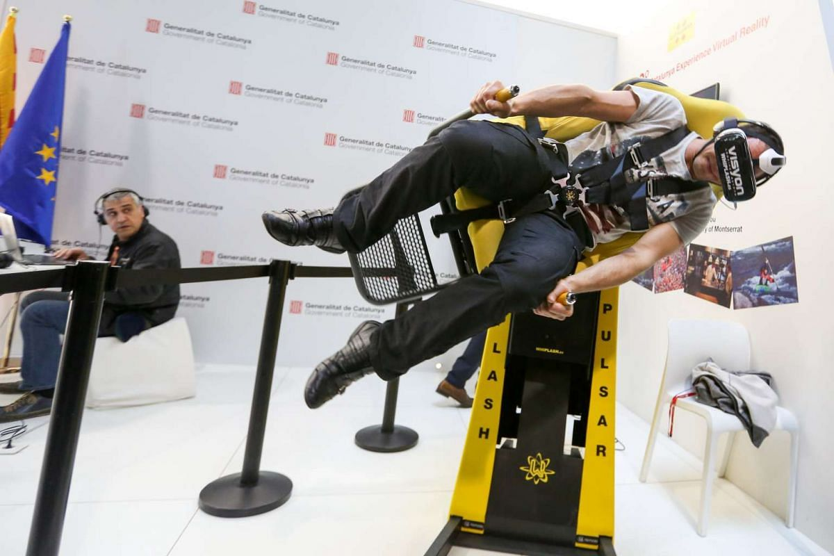 An attendee tries out a virtual reality experience at the Mobile World Congress in Barcelona, Spain, on Feb 24, 2016. PHOTO: BLOOMBERG/CHRIS RATCLIFFE