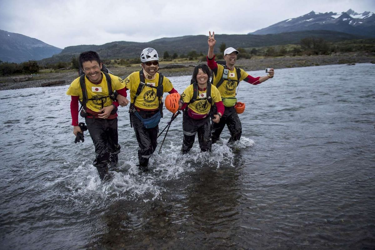 Japan's East Wind team members cheer after arriving in second place in the Patagonian Expedition Race in the southern Chilean Patagonia, near Estancia Perales, on Feb 24, 2016. PHOTO: AFP/MARTIN BERNETTI