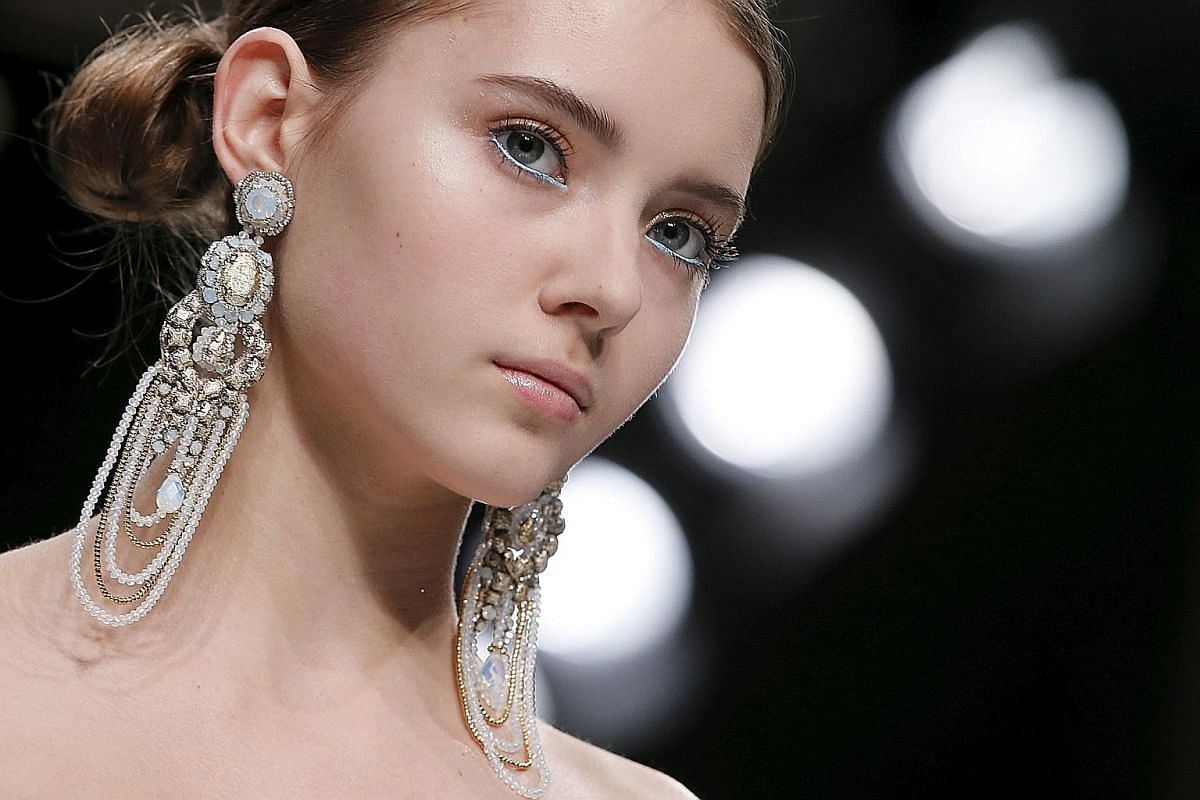 Black tassel earrings, $14.90, from H&M. Arden chain earrings, $269, from Goldheart. Brass and acrylic geometric earrings, $35.90, from Zara. A model with shoulder duster earrings on the runway for Chinese designer Guo Pei's Haute Couture Spring/ Sum