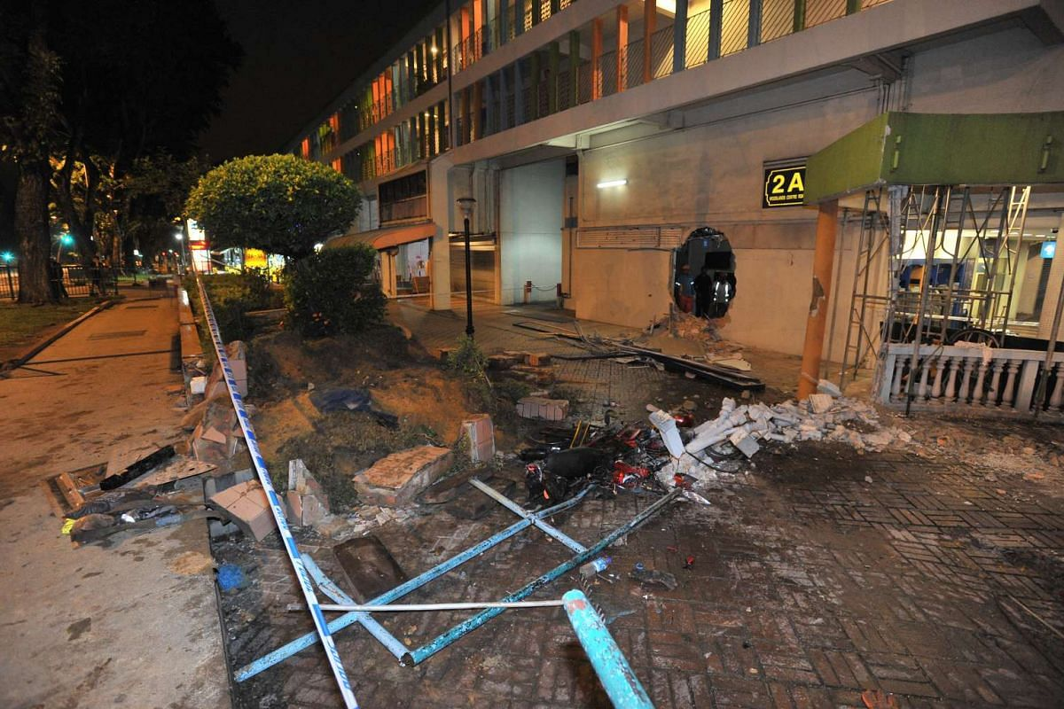 The crash site with the hole in the wall at 3.21am, after the mobile crane was removed, on Feb 25, 2016.