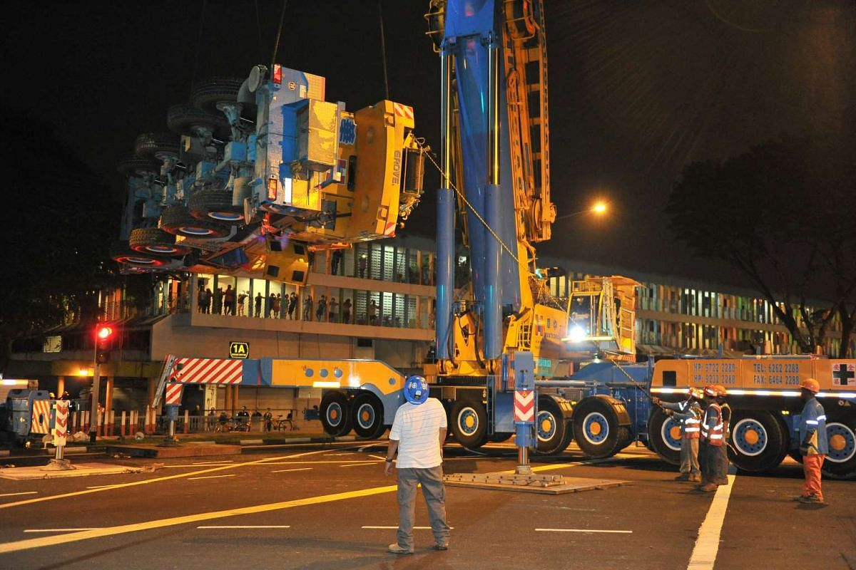 The mobile crane hoisted into the air at 2.32am before being loaded onto the trailer, on Feb 25, 2016.
