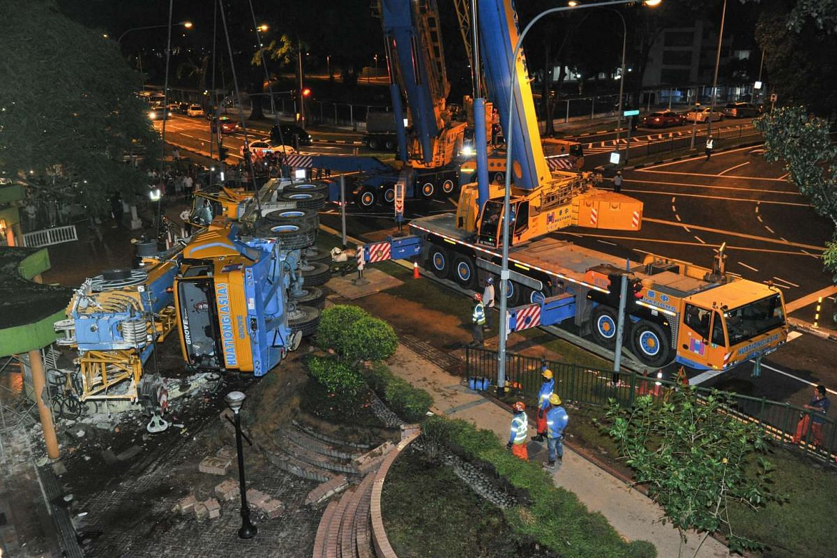 The mobile crane being removed from the crash site at 2.28am, on Feb 25, 2016.
