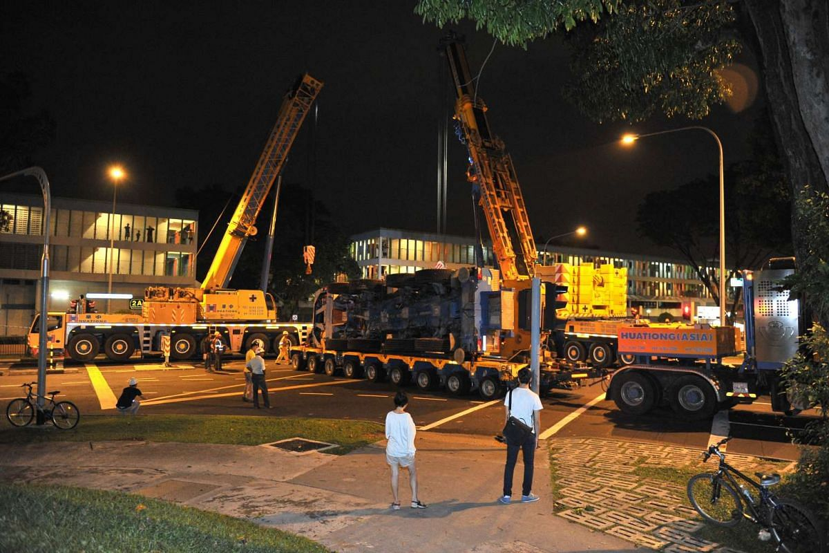 The mobile crane loaded onto the trailer at 3.08am before it moved off, on Feb 25, 2016.