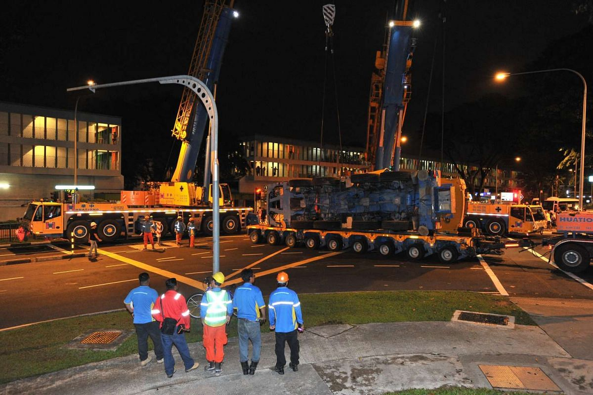 The mobile crane being loaded onto the trailer at 2.44am, on Feb 25, 2016.