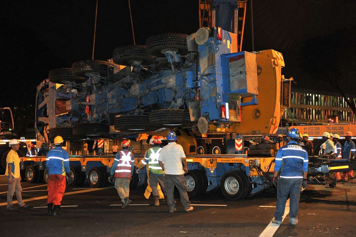 The mobile crane being loaded onto the trailer at 2.36am, on Feb 25, 2016.