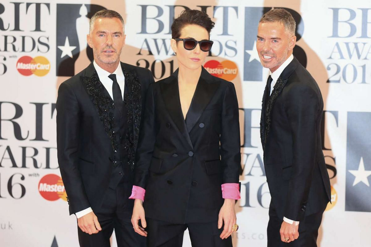 Designers Dean Caten (left) and Dan Caten, and Swedish actress Noomi Rapace (centre), arriving at the O2 Arena in London.