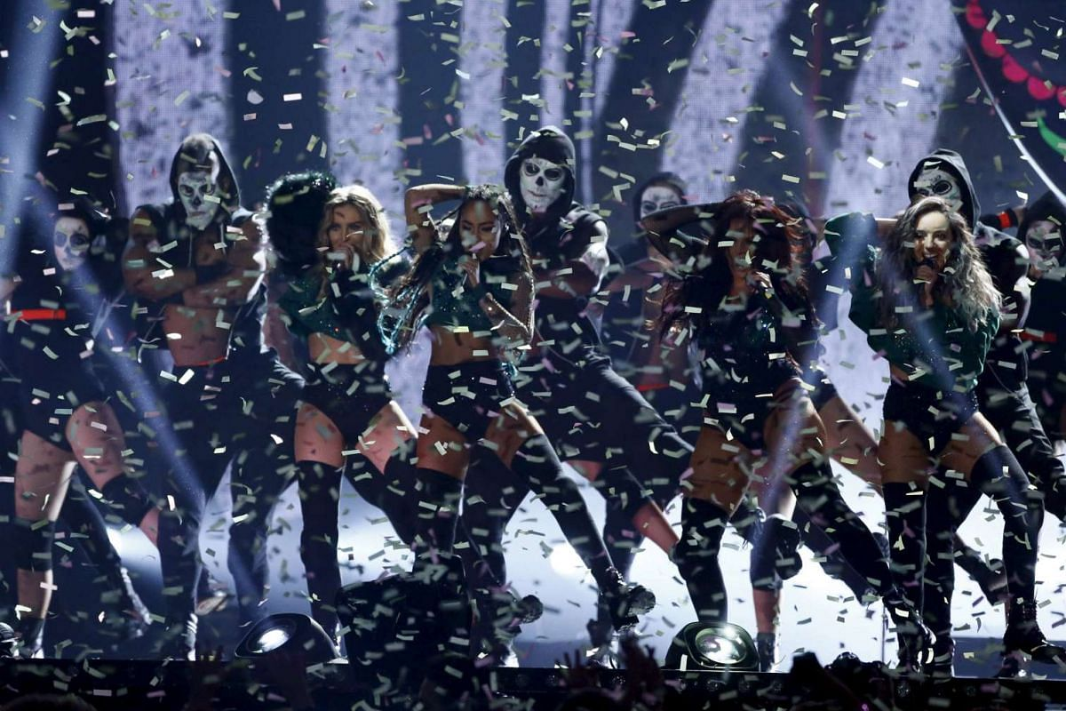 Girl group Little Mix performing at the Brit Awards.