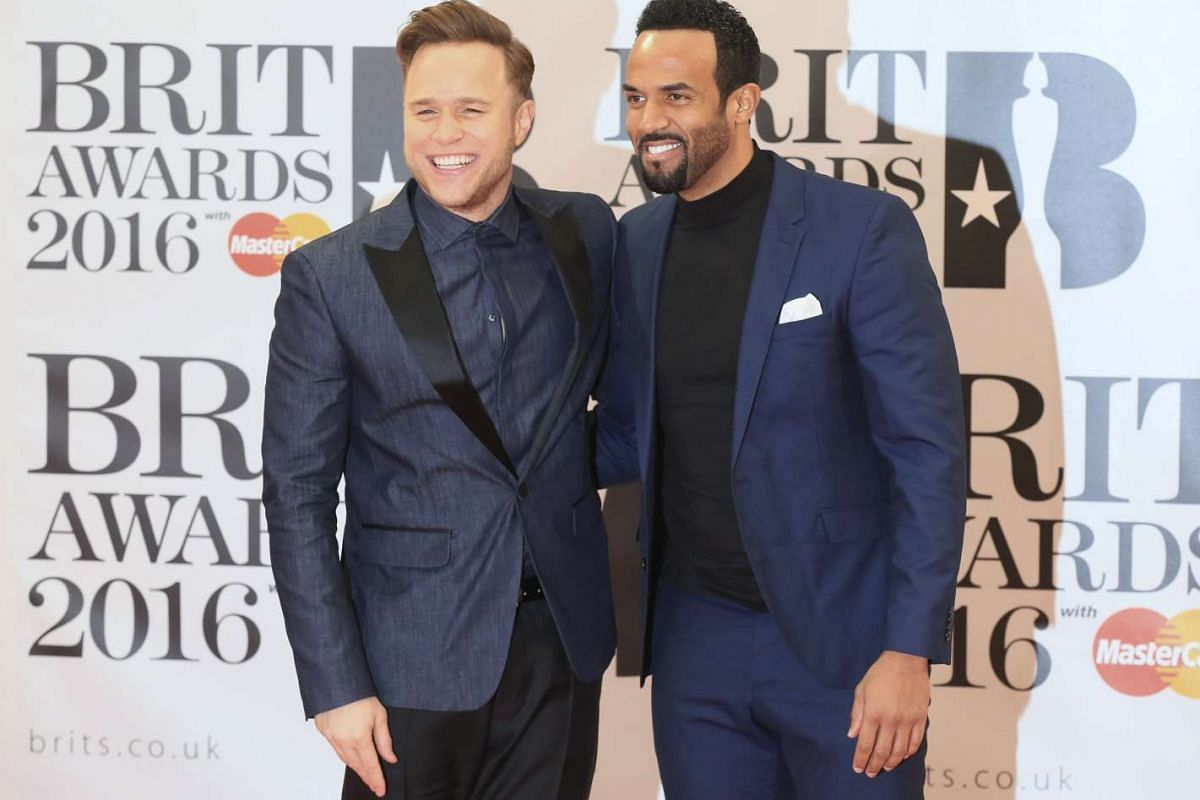 British singers Olly Murs (left) and Craig David arriving at the Brit Awards at London's O2 Arena.