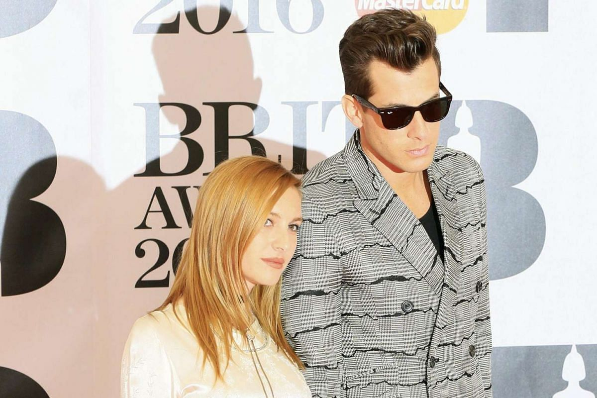 British musician Mark Ronson and his wife, French singer Josephine de La Baume, arriving at the O2 arena in London.