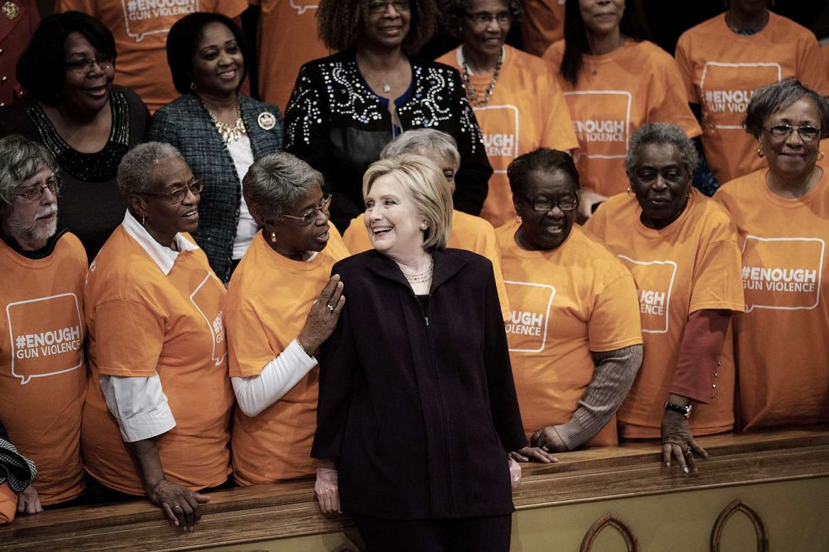 Hillary Clinton, former Secretary of State and 2016 Democratic presidential candidate, center, speaks with attendees while standing for a photograph during a town hall event at Cumberland United Methodist Church in Florence, South Carolina, U.S., on