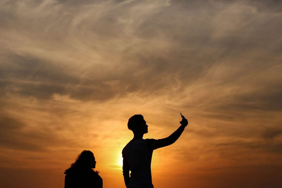People take selfies at the Bandra Fort Band Stand, a famous tourist spot near the Arabian sea, in Mumbai, India, February 25, 2016. According to reports, around 19 people have died taking selfies in India since 2014. Mumbai has now banned selfies in