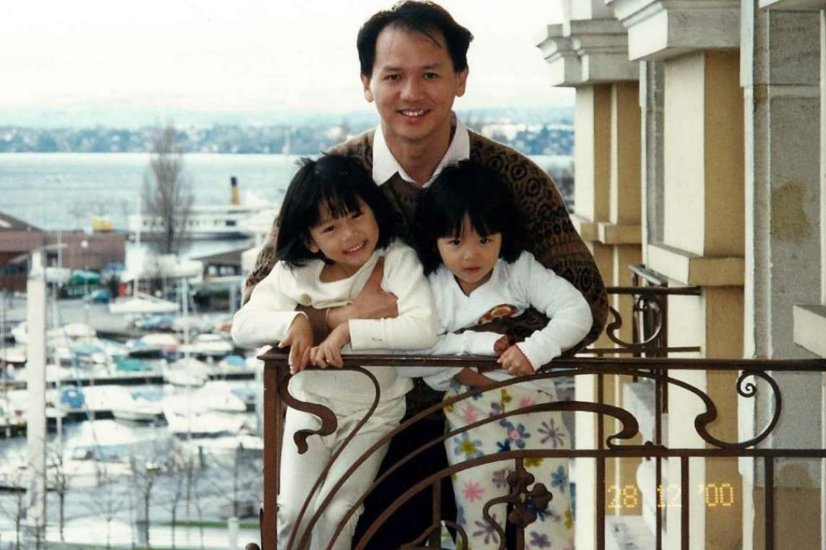 My life so far: Mr Chang in Switzerland in 2000 with his daughters Lea (right) and En (left).