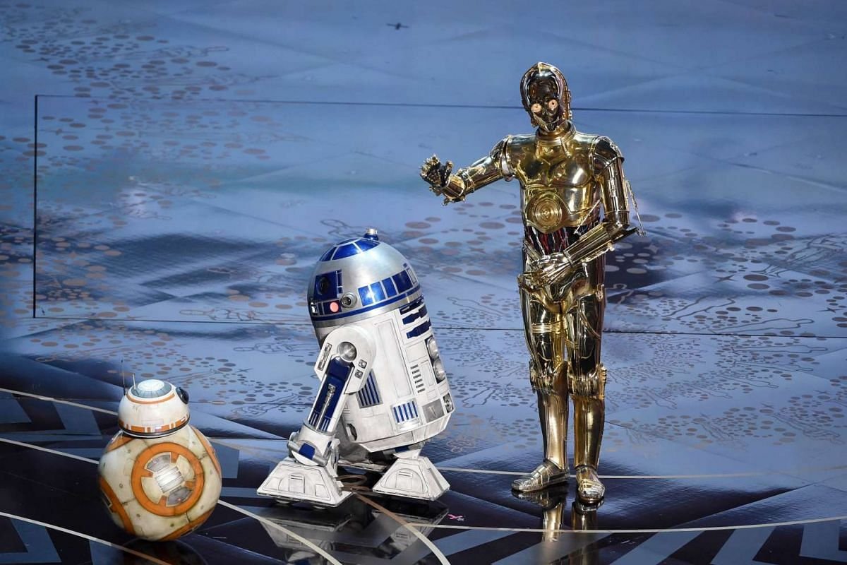 STAR WARS DROID C-3PO (above right), on the iconic gold Oscars statue, while honouring Star Wars composer John Williams with (from left) BB-8 and R2-D2.