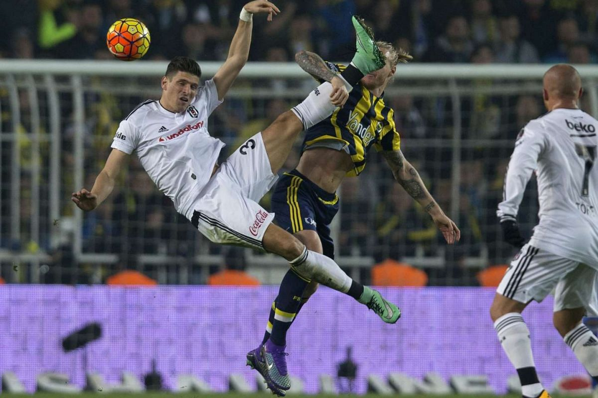 Mario Gomez (left) in action against Fenerbahce's Simon Kjaer (right) during the Turkish Super League match between Fenerbahce and Besiktas in Istanbul, Turkey, on Feb 29, 2016.