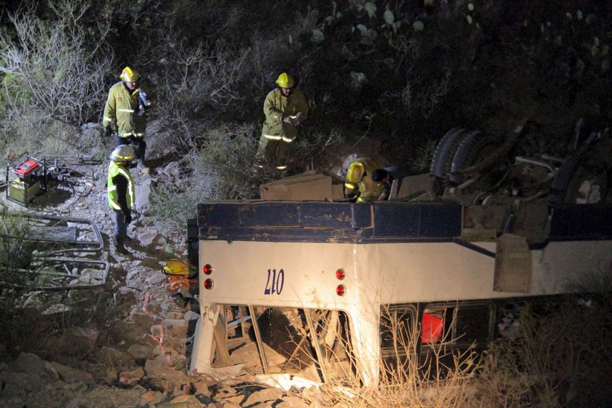 Rescue workers inspecting a bus following an accident in Mapimi, in Durango state, Mexico, on Feb 27, 2016.