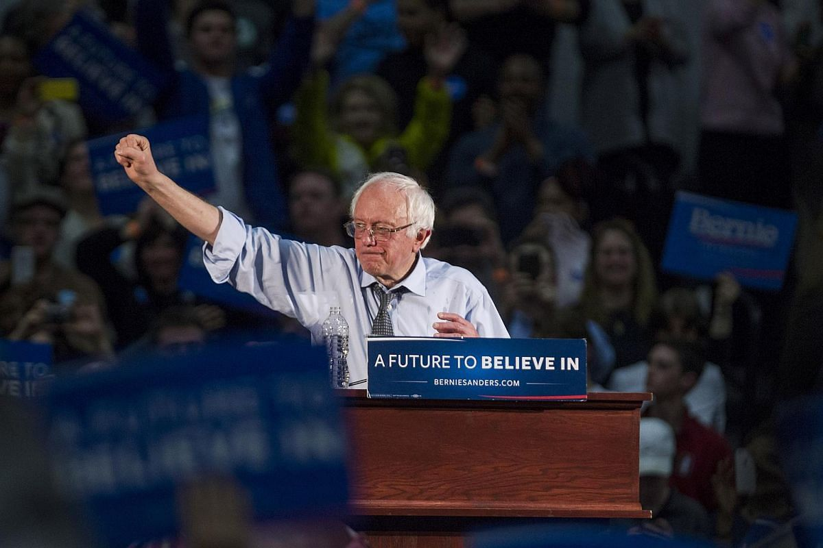Senator Bernie Sanders, an independent from Vermont and 2016 Democratic presidential candidate, raising his fist after speaking during a campaign rally at Milton High School on Feb 29, 2016.