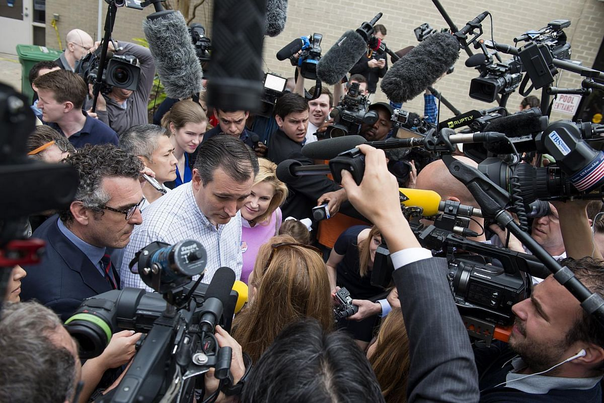 Senator Ted Cruz (centre), a Republican from Texas and 2016 presidential candidate, speaking to the media while leaving a polling station in Texas on March 1, 2016.