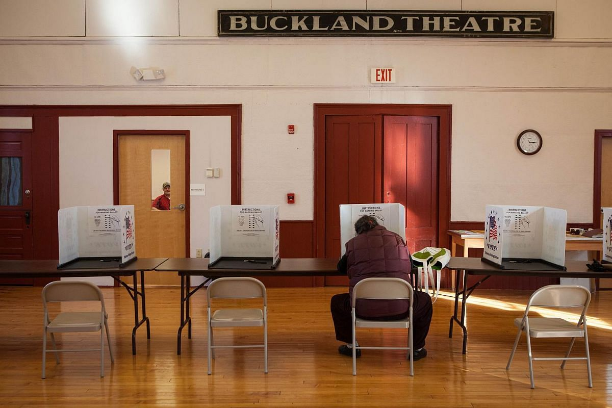 A voter casting a ballot in the Buckland Town Hall on March 1, 2016, in Buckland, Massachusetts.