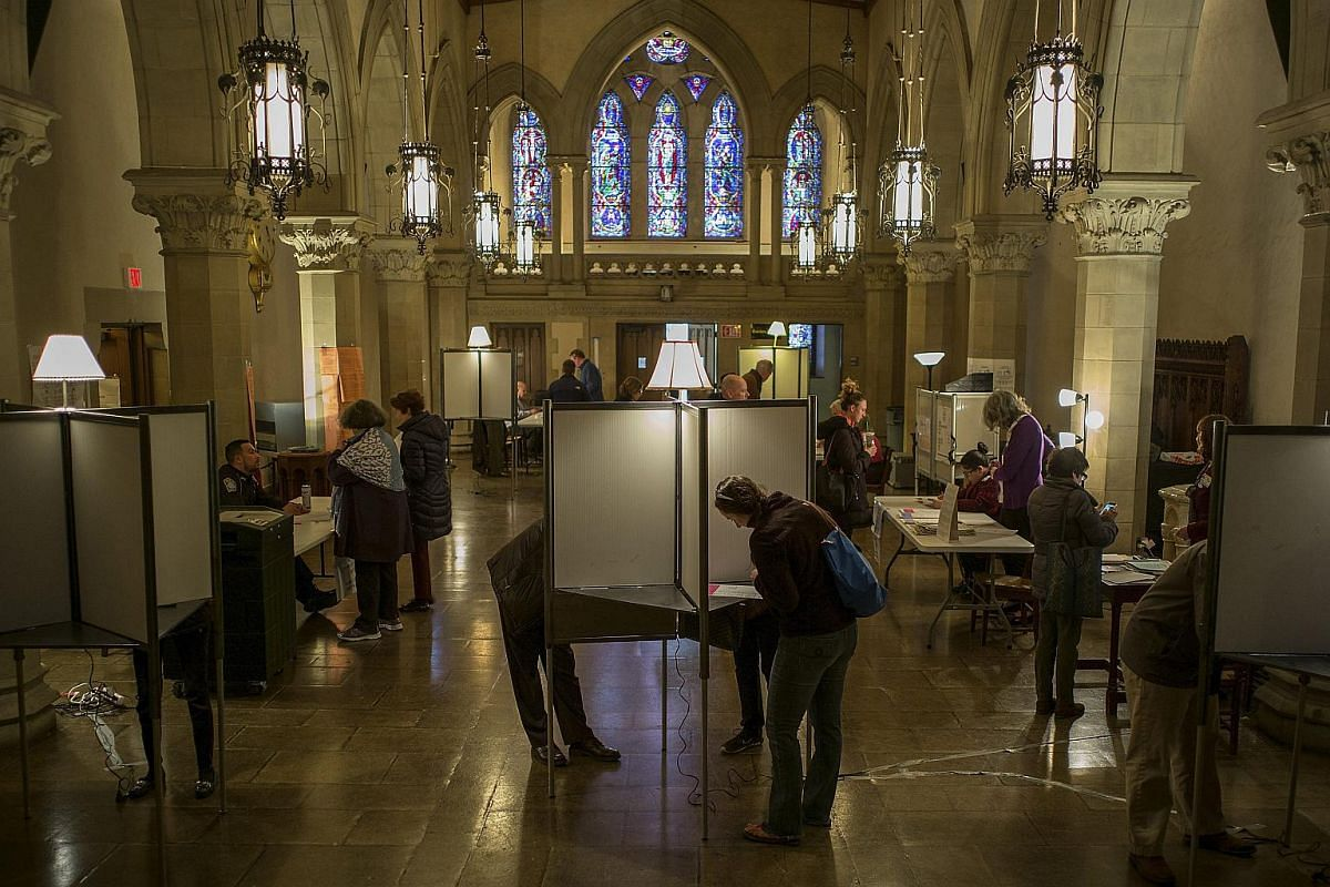 Voters casting their ballots at the Old South Church polling place in Massachusetts on March 1, 2016.