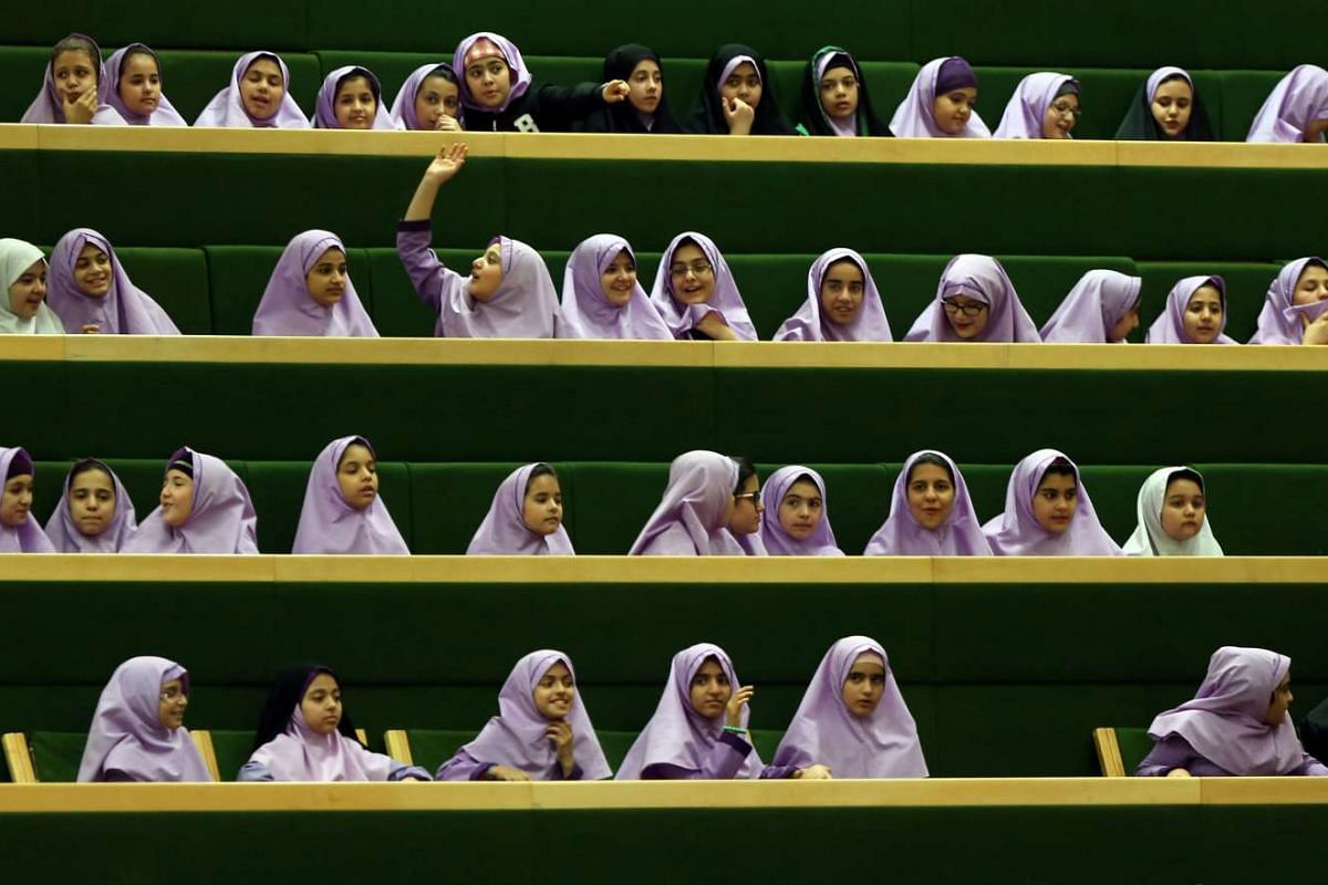 Iranian school girls attending a session of the outgoing Iranian Parliament in Teheran, Iran, on March 1, 2016.